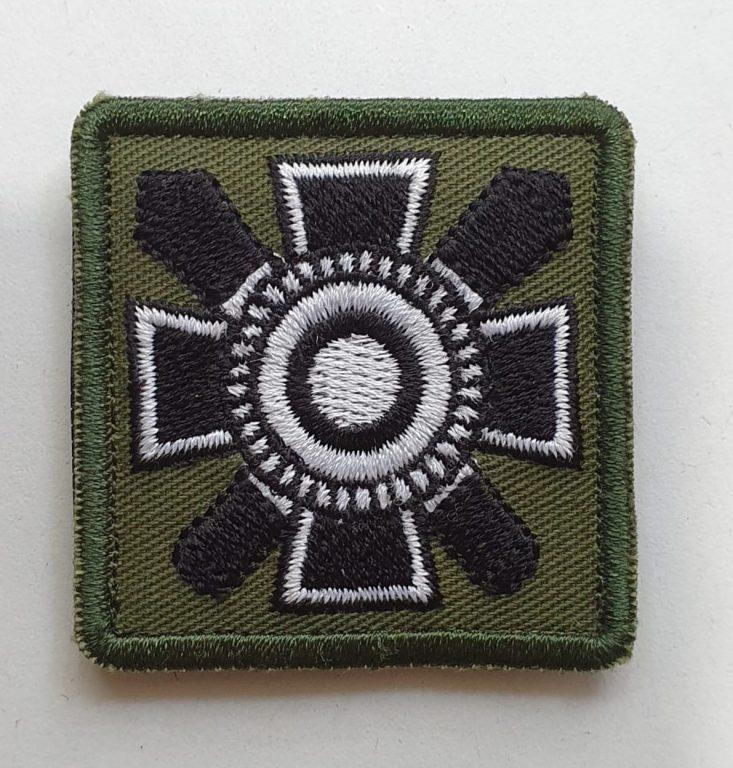 kangasmerkki logolla